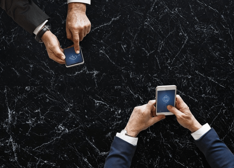 two men with two phones